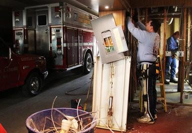 Electrician Ivan Tarabocchia works inside the Little Ferry Fire Department back in December 2012.