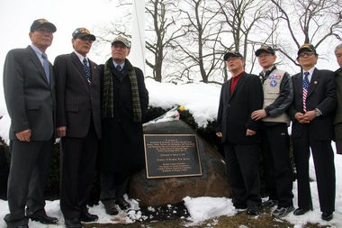Korean-American veterans stand in front of the comfort women memorial after its dedication on Friday, March 8, 2013.