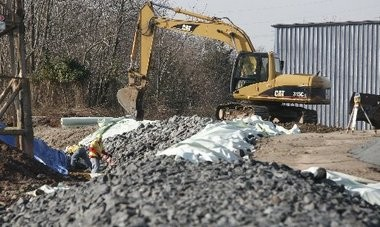 Workers repair the berm surrounding the American Cyanamid site in Bridgewater in this 2009 file photo. On Friday, the EPA announced plans to perform similar work at a contaminated site in Maywood and Rochelle Park.