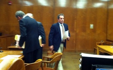 Thomas Rica leaves a courtroom after pleading guilty to four counts of theft, March 19, 2014.