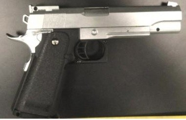 This pellet gun, designed to look like a semi-automatic handgun, was seized by police in the arrest of two men on robbery charges, authorities said.