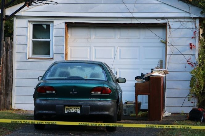 The Spring Valley Road garage where the body of Susana Lopez, 56, was found. Her son Jesus is charged in her murder.