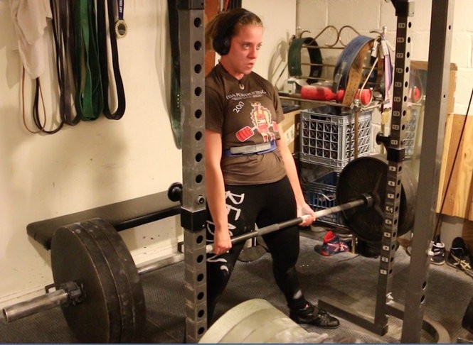 "Naomi ""Supergirl"" Kutin deadlifts 315 pounds in the basement of her Fair Lawn home. (Anthony G. Attrino 