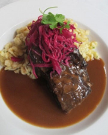 Among the dishes featured on the Satis Bistro menu is the ginger short rib entree.