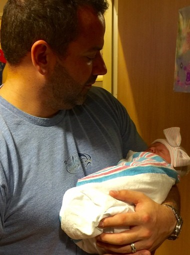 Steve Melchiore holding his newborn baby daughter, Portia. She was born in the family's pickup truck on Dec. 29, while Steve and his wife, Keshia, rushed the hospital. (Photo provided by Steve Melchiore)