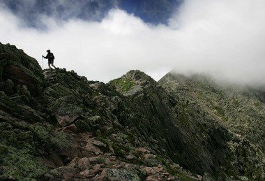 A man hikes toward the summit of Mount Katahdin at Baxter State Park in Maine in this file photo. A hiker from New Jersey had to be rescued from a mountain in the park about a mile away on Saturday afternoon. (AP Photo/Robert F. Bukaty/FILE)