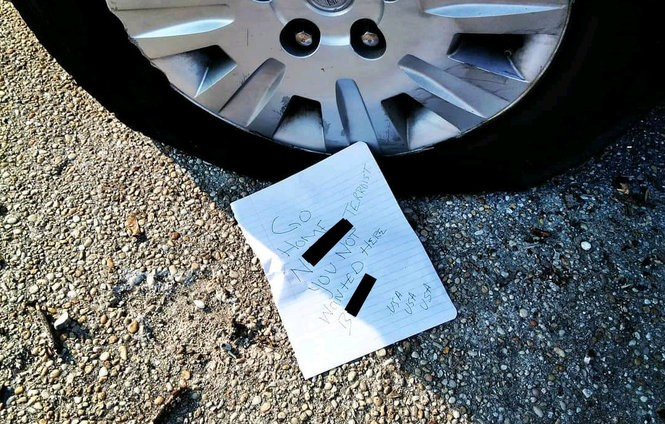 The note left on Kenya Robinson's tire April 11, redacted to remove profanities. (Provided photo)