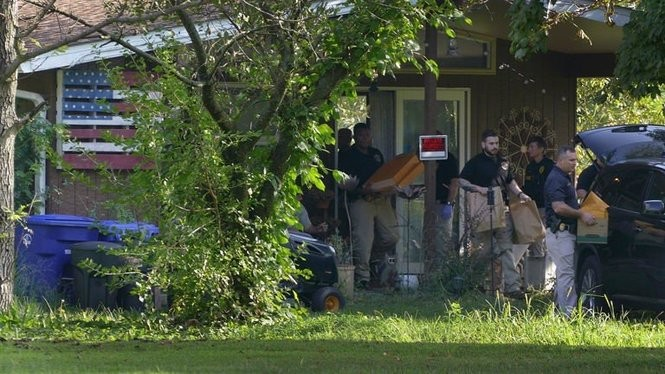 Authorities execute a search warrant at D'Amico and McClure's Florence Township home on Thursday, Sept. 6, 2018.