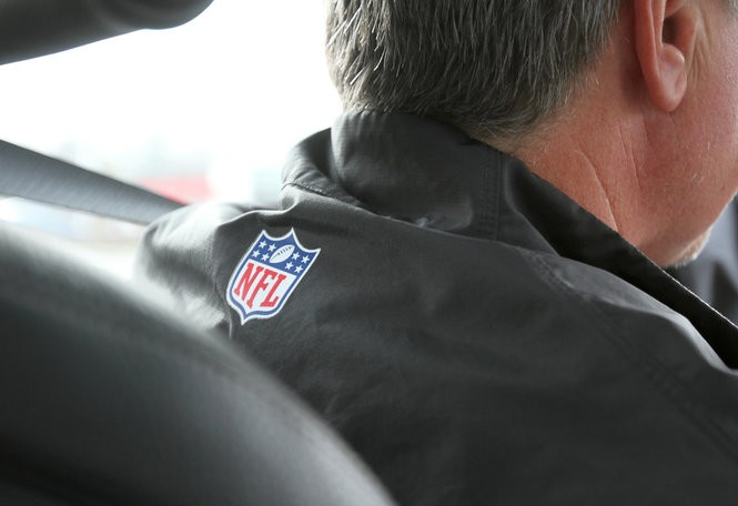Evesham Mayor Randy Brown rides his BMW around Marlton, Friday, Jan. 8, 2016. Brown, the Baltimore Ravens kicking coach, has bowed out of the race for mayor. (File photo)