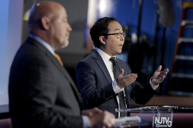 Challenger Andy Kim, right, has overtaken incumbent Rep. Tom MacArthur, R-3, as absentee and provisional ballots continued to be counted Thursday. (AP Photo/Julio Cortez)