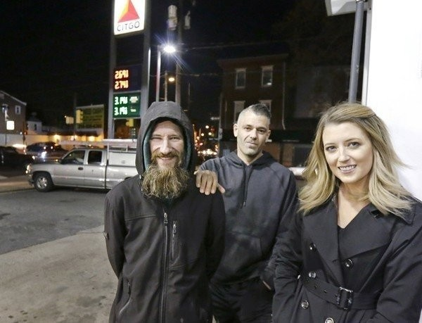 In this Nov. 2017, file photo, Johnny Bobbitt Jr., left, Kate McClure, right, and Mark D'Amico pose at a Citgo station in Philadelphia. (Elizabeth Robertson/The Philadelphia Inquirer via AP)