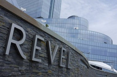 A bill that would legalize online gambling anywhere in New Jersey could save the struggling resort town, a securities analyst said today, urging Gov. Chris Christie to approve the measure. Some had bet the the new Revel, seen here, would give a boost to the city when it opened last spring, but that hasn't happened.