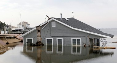 A summer home remained submerged in Barnegat Bay a month after Hurricane Sandy ravaged the Normandy Beach section of the Brick Township.