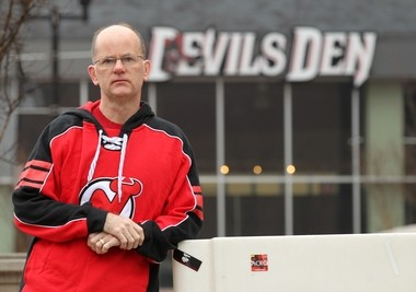Charles Vinicombe, a long-time season ticket holder for the Devils, poses in front of the Prudential Center. With the labor dispute and abbreviated season, he wanted to cancel his season tickets for this year but still keep his place for tickets for next season. The Devils said no.