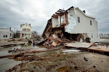 A Sea Bright house that was knocked off its foundation by Hurricane Sandy. Since the storm, many homeowners say they've had trouble collecting on their flood insurance.