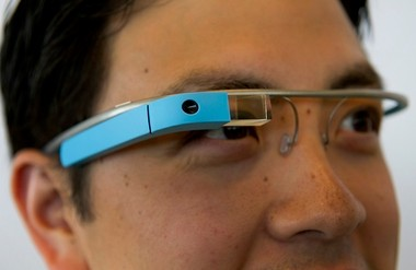 """A Google employee wears Project Glass internet glasses during a demonstration last year. """"Like it or not, we're getting closer and closer to the point where there's a nearly seamless boundary between what's on the internet and what's in our minds,"""" Allan Hoffman writes."""