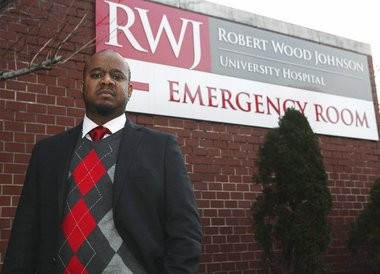 Lemar White in front of the Robert Wood Johnson University Hospital Emergency Room. A previous visit resulted in collections calls and damage to his credit report.