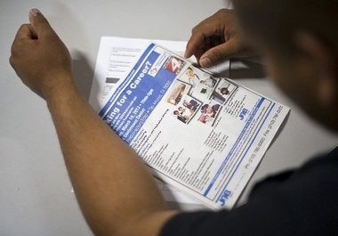 Half of all low-wage workers lack confidence that their job will help them achieve long-term success. In this photo a job seeker fills out an application at a San Antonio job fair on Tuesday.