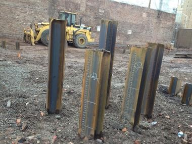Steel beams are in the ground to start erected the next phase of Teachers Village in Newark.