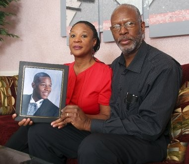 Carolyn and Derek Mahoney hold a picture of their late son, Derek Jr. When Derek Jr. passed away, his parents were left with thousands in Sallie Mae student loans, and are currently looking for loan forgiveness.