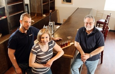 Rinn Duin Brewing, represented here by head brewer Jason Goldstein (left) and co-founders Jacqui Town and Chip Town, is looking to start brewing U.K.-style beers in a matter of weeks.