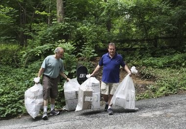 Camp treasurer Steven Birnbaum, left, and camp director Hal Pugach take a day's mail back across the street to load into a van at Camp Louemma, as part of a temporary mail delivery solution. The postal service is now delivering the mail to a camp building until the camp installs a mail shed.