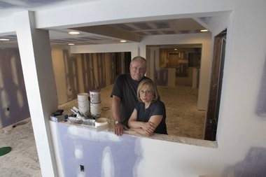Jack and Aleta Heir in their water damaged basement in 2012. The Heirs won a judgment against Watershield Waterproofing, a company believed to be linked to two other waterproofing companies that were previously profiled by Bamboozled.