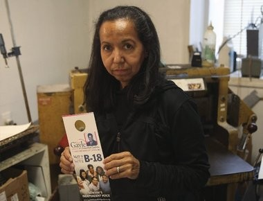 Businesswoman Idalia Williford holds some of the materials she produced for Gayle Chaneyfield-Jenkins; 2006 campaign. Williford received a $24,000 judgment against the candidate for unpaid funds.