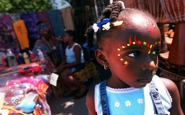 Monaysha Watson, 4, waits her sister Nakiyah's face painting done at Africa Festival in Military Park in 2000. The 16th annual Africa Festival was held in Military Park in downtown Newark.