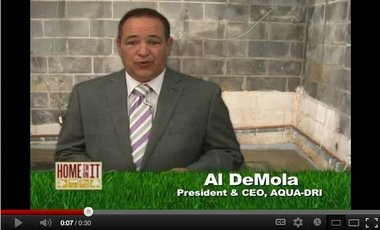 A still shot from a YouTube video of Al Demola promoting a waterproofing company.