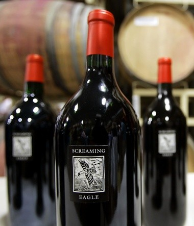 Joe Lentini purchased a bottle of Screaming Eagle wine, 2011 vintage, costing $3,750. Pictured here is a June 2, 2006 file photo showing three magnums of Screaming Eagle Cabernet Sauvignon wine on display during the Napa Valley wine auction in Rutherford, Calif.