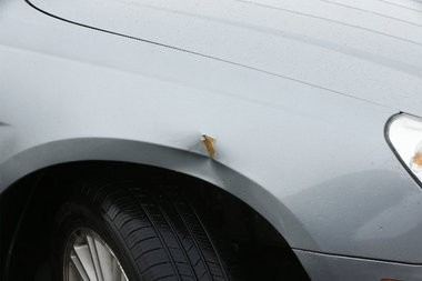 The dent on Dayna Miller's car. She said the car was hit by runaway shopping carts at Sam's Club in Edison.