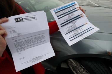 Dayna Miller holds the accident report and claim denial letter she received from Sam's Club after she said her car was damaged by runaway shopping carts.