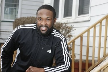 Chaz Epps outside his new home. Epps' battled a credit reporting firm that confused his identity with that of his felon brother.