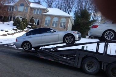William Koeller's car was loaded onto a transport in January. On its way to Florida, Koeller's E-ZPass was charged tolls.
