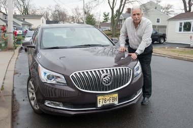 Ralph Vuolo stands with his car. He's been trying to get E-ZPass to respond to his complaints about violation notices.