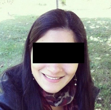 """The profile photo shown on the Facebook page for """"Kim."""" The photo is blacked out to protect the woman's identity in case her photo was stolen by a scammer."""