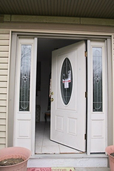 "Steven Kenner's front door, showing the sticker and number ""6"" that was written on the door."
