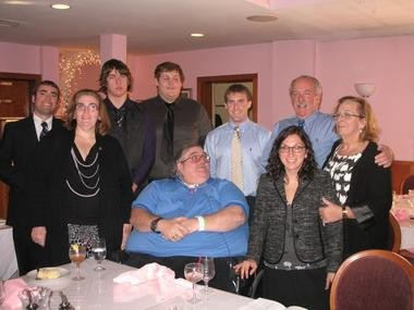 The Nagle family gathers to celebrate the life of Terry Nagle after her funeral. Pictured left to right in the back row are Terry Nagle's grandchildren Ed, Dan, Justin and Gavin, and her children Ed and Anne. In the front row left to right are Terry Nagle's children Kathleen and Richard, and grandchild Erin.
