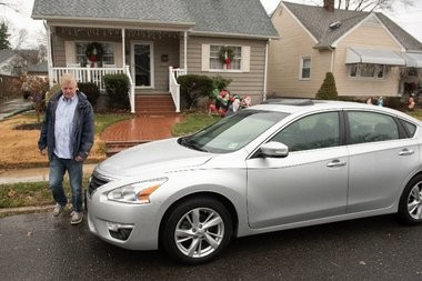 Ken Lowenstein walks to his car.