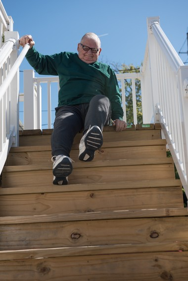 Don Seckler goes down the steps from his Pelican Island home on his bottom. Russ DeSantis | For NJ Advance Media