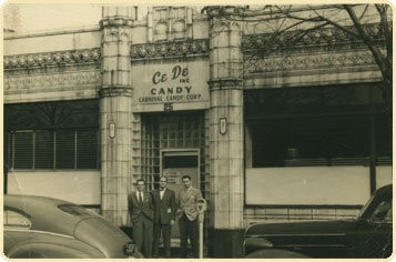 From left, Milton Honig, Sid Honig and Eddie Dee in front of the original Bloomfield candy factory in 1952.