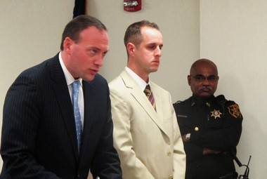Former Triton High School teacher Daniel Michielli, center, and lawyer Leonard Biddison, left, appear in Superior Court on Friday, March 15, 2013, in Camden, N.J. Michielli was sentenced to 30 days of home confinement for an official conduct conviction that stemmed from an inappropriate relationship with a student. (AP Photo/Geoff Mulvihill)
