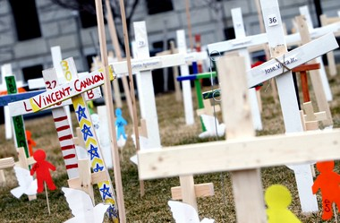 Over 700 crosses and other memorials are placed in Roosevelt Park, in front of Camden City Hall, by members of Stop Trauma on People (S.T.O.P) and other various members of the community, Tuesday, Jan. 29, 2013. The memorials represent the number of victims lost to violence, poverty and trauma in the city from 1995 through 2012. (Staff Photo by Lori M. Nichols/South Jersey Times)