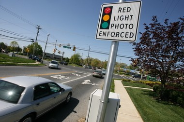 A sign alerting drivers of a red light camera at the intersection of Delsea and Dalton drives in Glassboro. (Photo by Tim Hawk/South Jersey Times)