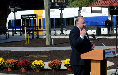 Senate President Stephen Sweeney speaks at the opening ceremony at New Jersey Transit's Pennsauken Transit Center, as a RIVERLine train passes, Monday Oct. 14. Monday marked the grand opening of the center, connecting New Jersey Transit's River Line with the Atlantic City line. (Photo by Tom Scott/South Jersey Times)