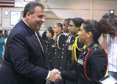 Gov. Chris Christie shakes hands with Camden High School JROTC cadet Joselyn Chevere, 16, during a press event at the school, Monday, June 9, 2014. Christie announced the partnership with Center for Family Services Camden Promise Program and showed support for school Superintendent Paymon Rouhanifard at the event. (Staff Photo by Lori M. Nichols/South Jersey Times)