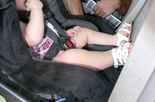 A car seat inspector checks out a parent's car seat in this 2012 file photo. Camden County police say an officer on foot patrol found a baby alone in a car Thursday morning and broke the glass to rescue the child.