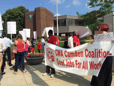 Union workers listen to CWA national staff representative Jim McAsey speak against the possible privitazation of police dispatch during a march and rally in Camden City, July 7, 2015. (Michelle Caffrey | For NJ.com)