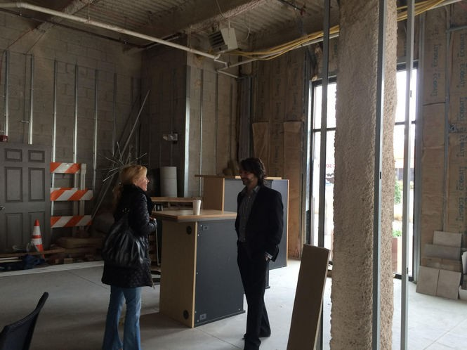 Kathy and Anthony Abate check out the retail space in the Lumberyard in Collignswood, where they plan on opening Devil's Creek Brewery this spring. (Alex Young | For NJ.com)